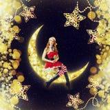 De zitting van de Kerstman van de Kerstmisvrouw op maan stock fotografie