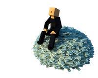 De zitting van de mens op een stapel van geld Stock Fotografie
