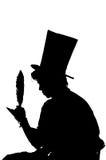 De zitting van de silhouetmens op een kruk terwijl het schrijven royalty-vrije illustratie