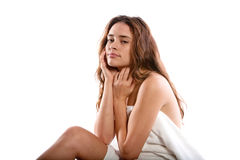 De zitting van de vrouw op massagelijst stock afbeeldingen