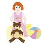 De zitting van het babymeisje op de speelgoeddoos Royalty-vrije Stock Afbeelding