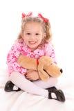 De zitting van het meisje met hond stock foto's