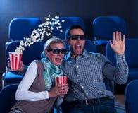 Paar die in schok aan een 3D film reageren Royalty-vrije Stock Fotografie
