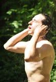 De zomerdouche Stock Foto's