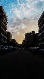 De zon bouwt de hemel van de autowolk Royalty-vrije Stock Afbeelding