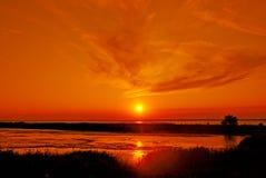 De zon van de zonsondergang in overzees Stock Foto
