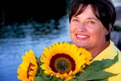 De zonnebloemen van de vrouw Royalty-vrije Stock Foto