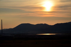 De zonsondergang Royalty-vrije Stock Afbeeldingen