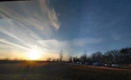 De Zonsondergang bij dageraad stock foto's