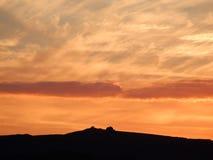 De zonsondergang over legt vast Stock Foto