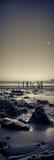 De zonsondergang over pier blijft Stock Foto's