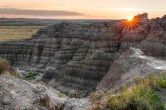 De Zonsondergang van Badlands stock afbeeldingen