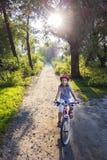 De zonsondergang van Biking Royalty-vrije Stock Afbeelding