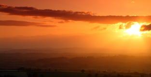 De zonsondergang van de brand Stock Afbeeldingen