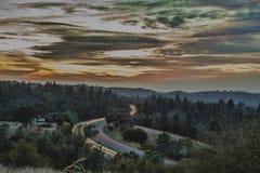 De zonsondergang van de brandweg Stock Fotografie