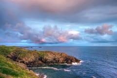 De zonsondergang van de kustlijn hdr Stock Fotografie