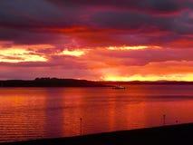 De zonsondergang van de Largsveerboot Stock Foto's