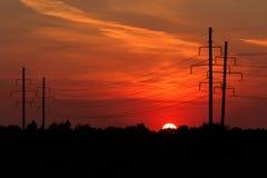 De zonsondergang van de macht stock foto