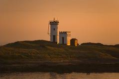 De zonsondergang van de vuurtoren royalty-vrije stock foto