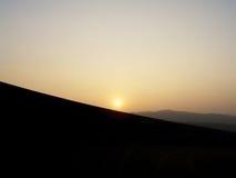 De zonsondergang van de woestijn Stock Fotografie