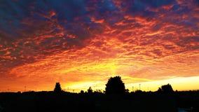 De zonsondergang van de zondagavond Stock Foto's
