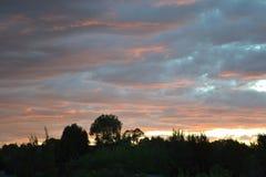 De Zonsondergang van het land Stock Afbeeldingen