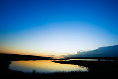 De Zonsondergang van het meer royalty-vrije stock foto