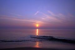 De zonsondergang van het strand Stock Afbeelding