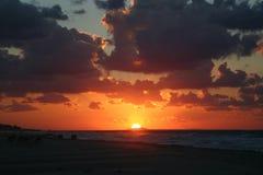 De Zonsondergang van het strand Stock Foto