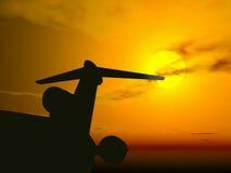 De zonsondergang van het vliegtuig @ Royalty-vrije Stock Afbeeldingen
