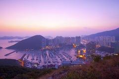 De zonsondergang van Hongkong bij heuveltop stock afbeelding
