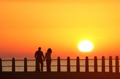 De zonsondergang van minnaars Stock Afbeelding