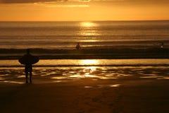 De zonsondergang van Surfer @ Royalty-vrije Stock Foto