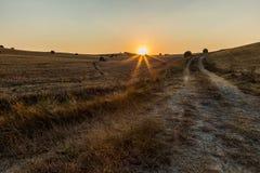 De zonsondergang van Toscanië stock afbeelding