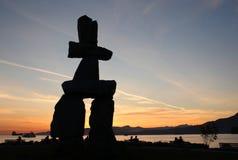 De Zonsondergang van Vancouver Inukshuk Stock Foto
