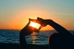 De zonsondergang vangt Stock Foto