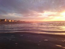 De zonsondergangstrand van het strandhuis Royalty-vrije Stock Afbeeldingen