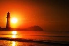 De zonsopgang van de vuurtoren Stock Afbeeldingen