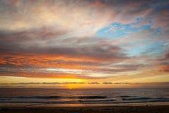 De Zonsopgang van het strand Stock Afbeelding