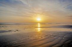 De Zonsopgang van het strand Stock Foto