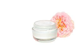 De Zorgschoonheid van de room Kosmetische Huid Organisch met roze bloem Stock Afbeeldingen