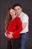 De zwangere vrouw en de man Royalty-vrije Stock Afbeeldingen