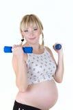 De zwangere vrouw isoleert stock foto's