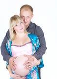 De zwangere vrouw met de mens isoleert royalty-vrije stock afbeeldingen