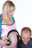 De zwangere vrouw met de mens isoleert stock foto