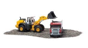 De zware bulldozer en de zware vrachtwagen Stock Afbeeldingen