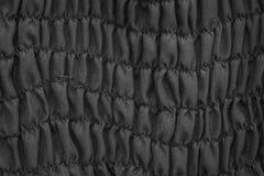 De zwarte achtergrond van de stoffentextuur Stock Foto