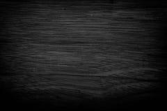 De zwarte achtergrond van de grungetextuur Houten grungetextuur op nood Stock Foto