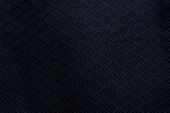 De zwarte achtergrond van de stoffentextuur Detail van canvas textielproduct stock foto's