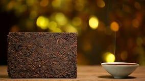 De zwarte Chinese lengte van thee gouden bokeh hd niemand stock footage